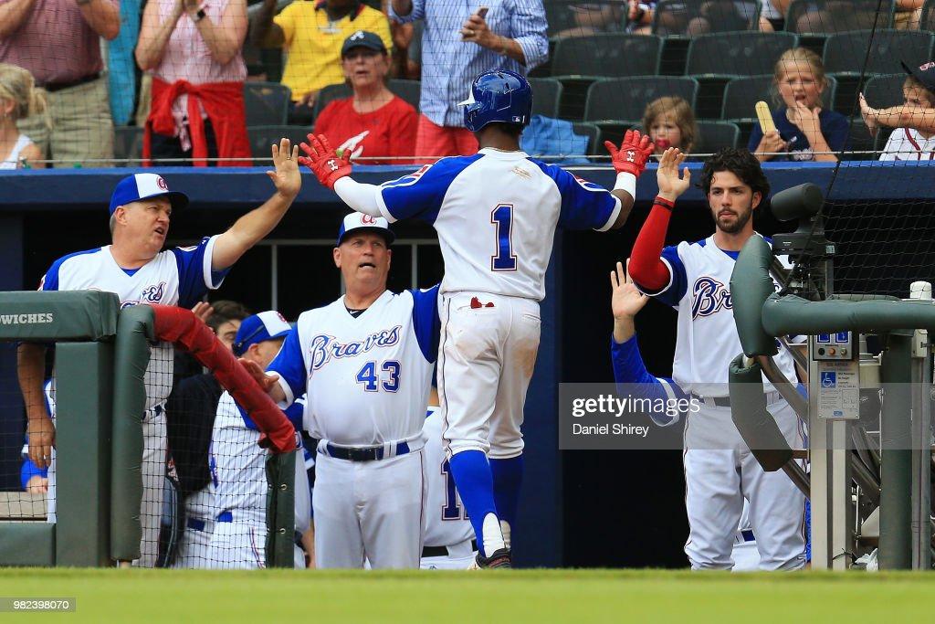 Ozzie Albies #1 of the Atlanta Braves celebrates scoring during the seventh inning against the Baltimore Orioles at SunTrust Park on June 23, 2018 in Atlanta, Georgia.