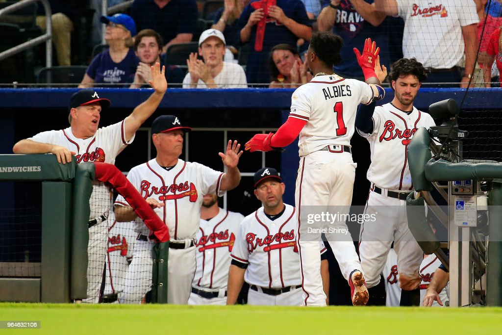Ozzie Albies #1 of the Atlanta Braves celebrates scoring on an RBI double by Freddie Freeman #5 during the third inning against the Washington Nationals at SunTrust Park on May 31, 2018 in Atlanta, Georgia.