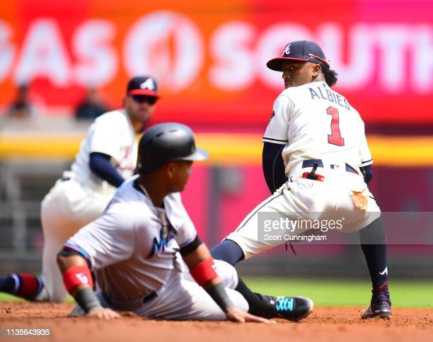 Ozzie Albies of the Atlanta Braves checks first base after forcing out Starlin Castro of the Miami Marlins during the third inning at SunTrust Park...