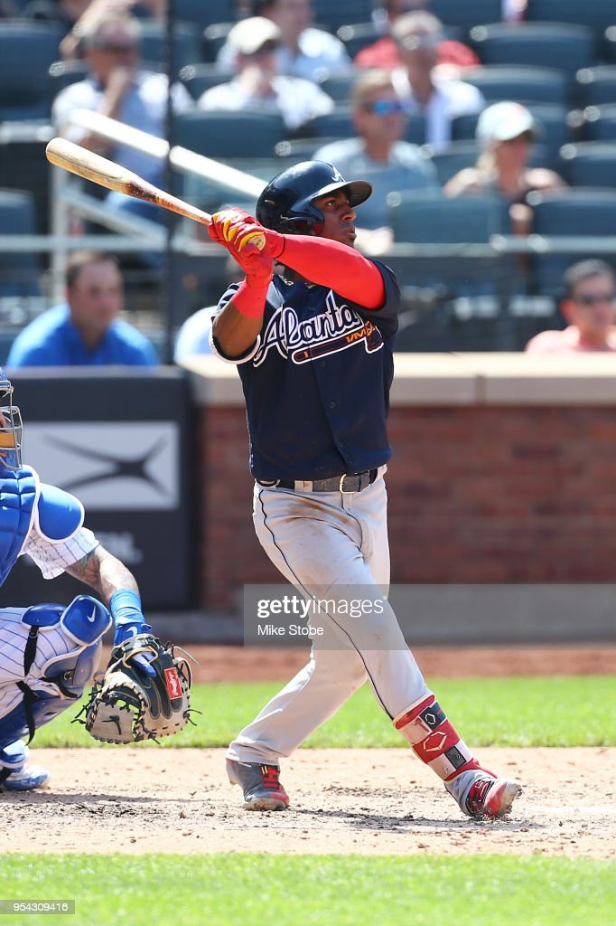 Ozzie Albies #1 of the Atlanta Braves connects on a 3-run home run in the seventh inning against the New York Mets at Citi Field on May 3, 2018 in the Flushing neighborhood of the Queens borough of New York City.