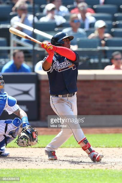 Ozzie Albies of the Atlanta Braves connects on a 3run home run in the seventh inning against the New York Mets at Citi Field on May 3 2018 in the...