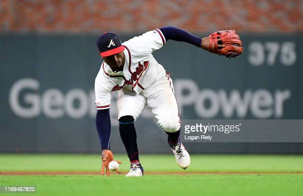 Ozzie Albies of the Atlanta Braves fields a ball in the seventh inning against the Miami Marlins at SunTrust Park on August 21 2019 in Atlanta Georgia