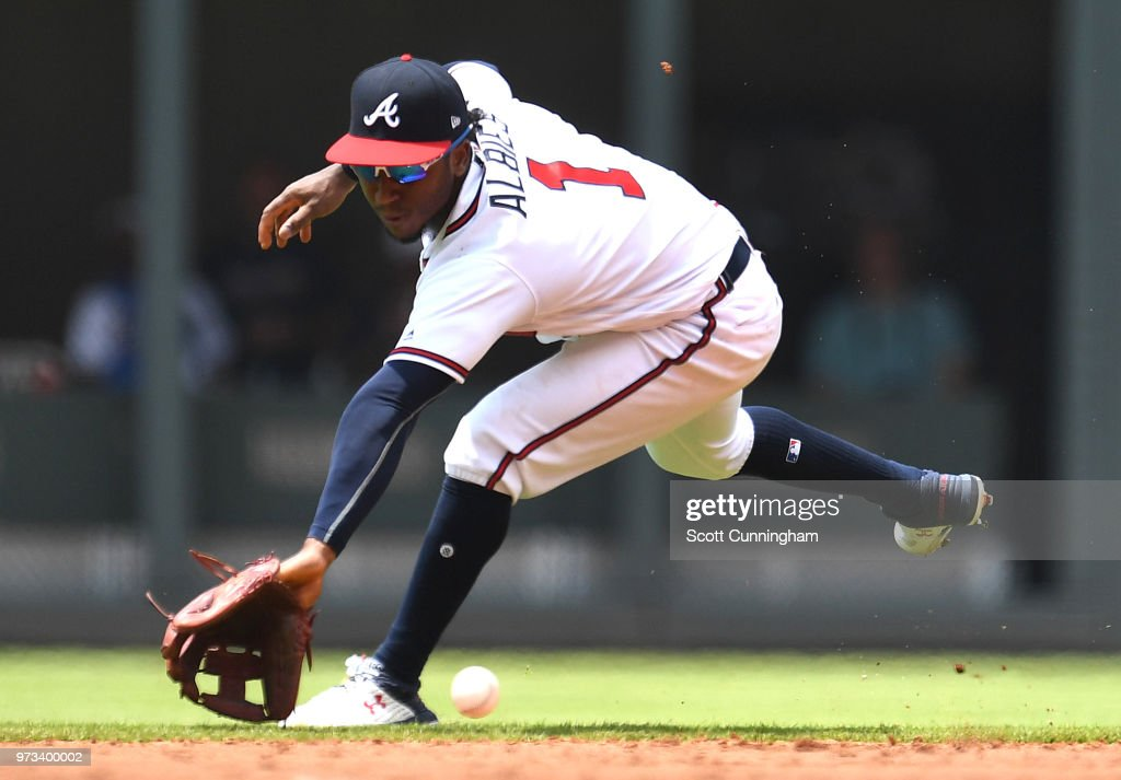 Ozzie Albies #1 of the Atlanta Braves fields a third inning ground ball against the New York Mets at SunTrust Field on June 13, 2018 in Atlanta, Georgia.