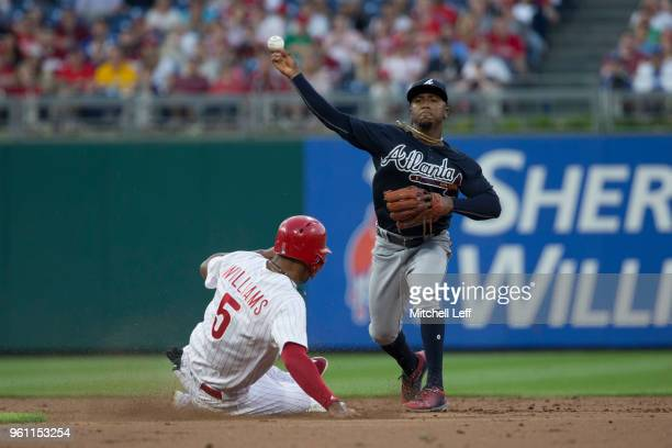 Ozzie Albies of the Atlanta Braves forces out Nick Williams of the Philadelphia Phillies and throws the ball to first base in the bottom of the...