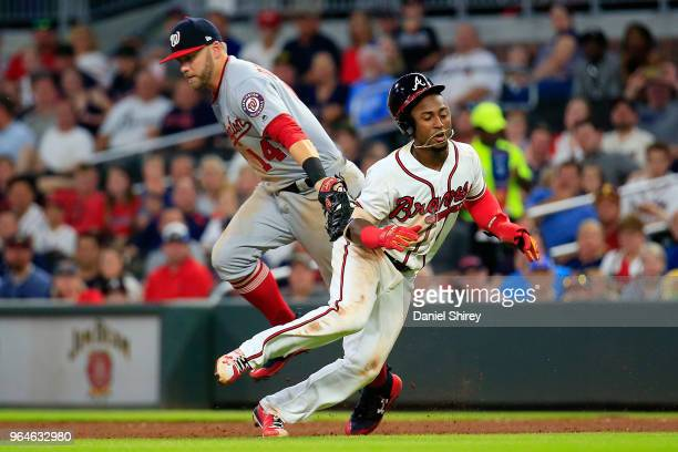 Ozzie Albies of the Atlanta Braves gets caught between the bases by Matt Adams of the Washington Nationals during the fifth inning at SunTrust Park...