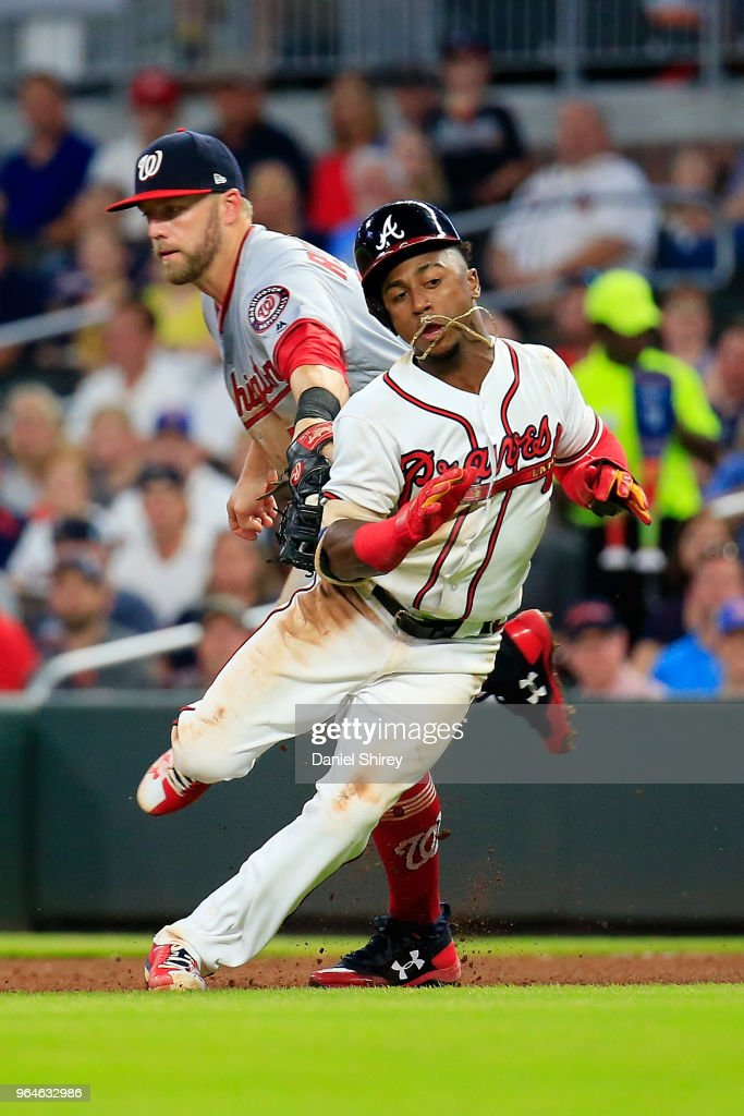 Ozzie Albies #1 of the Atlanta Braves gets caught between the bases by Matt Adams #15 of the Washington Nationals during the fifth inning at SunTrust Park on May 31, 2018 in Atlanta, Georgia.
