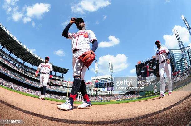 Ozzie Albies of the Atlanta Braves heads off the field after the first inning against the Miami Marlins at SunTrust Park on July 6, 2019 in Atlanta,...