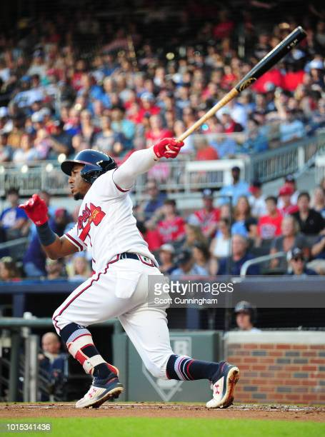Ozzie Albies of the Atlanta Braves hits a first inning single against the Milwaukee Brewers at SunTrust Park on August 11 2018 in Atlanta Georgia