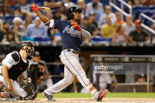 Ozzie Albies of the Atlanta Braves hits a grand slam in the sixth inning against the Miami Marlins at Marlins Park on May 10 2018 in Miami Florida