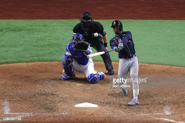 Ozzie Albies of the Atlanta Braves hits a solo home run against the Los Angeles Dodgers during the ninth inning in Game Two of the National League...