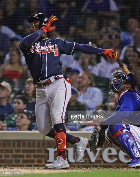 Ozzie Albies of the Atlanta Braves hits a two run home run in the 7th inning against the Chicago Cubs at Wrigley Field on June 25 2019 in Chicago...