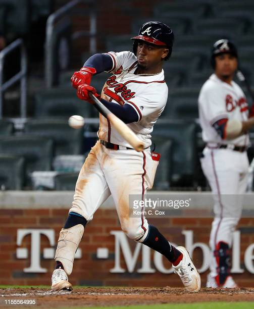 Ozzie Albies of the Atlanta Braves hits a walk-off double in the 11th inning against the Pittsburgh Pirates at SunTrust Park on June 12, 2019 in...
