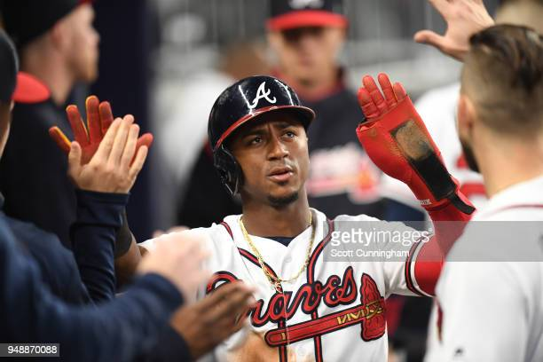 Ozzie Albies of the Atlanta Braves is congratulated by teammates after scoring a thirdinning run against the New York Mets at SunTrust Park on April...