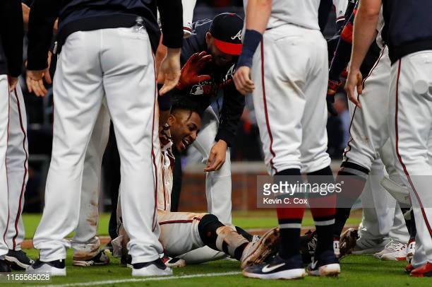 Ozzie Albies of the Atlanta Braves reacts with his teammates after hitting a walk-off double in the 11th inning against the Pittsburgh Pirates at...