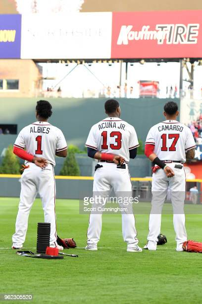 Ozzie Albies of the Atlanta Braves Ronald Acuna Jr #13 and Johan Camargo on the field against the San Francisco Giants at SunTrust Park on May 4 2018...
