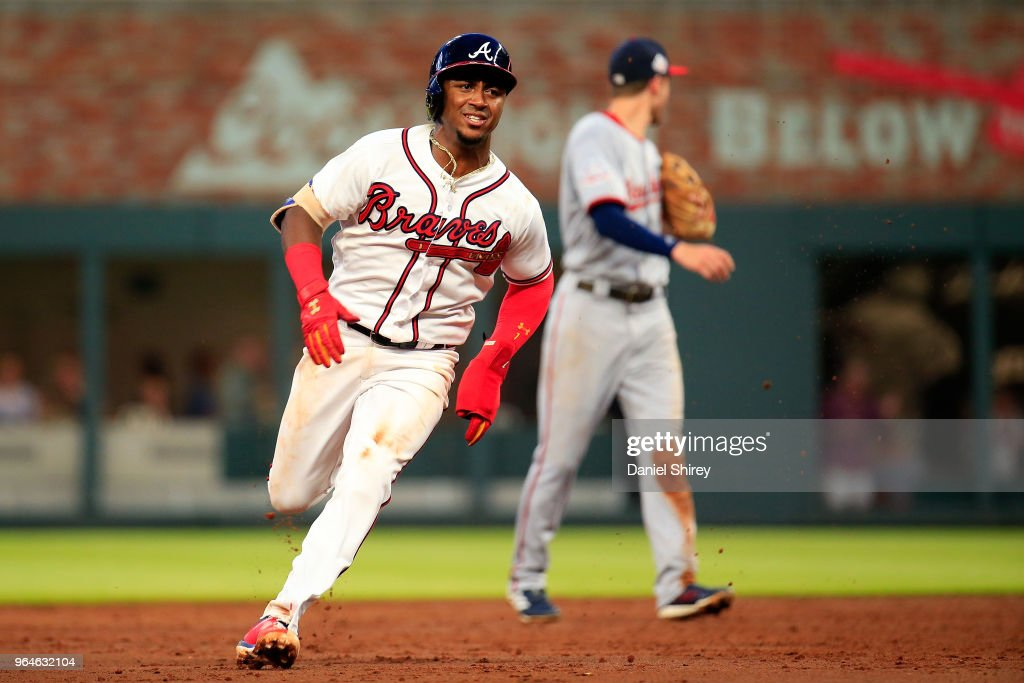 Ozzie Albies #1 of the Atlanta Braves rounds second on his way to score on an RBI double by Freddie Freeman #5 during the third inning against the Washington Nationals at SunTrust Park on May 31, 2018 in Atlanta, Georgia.