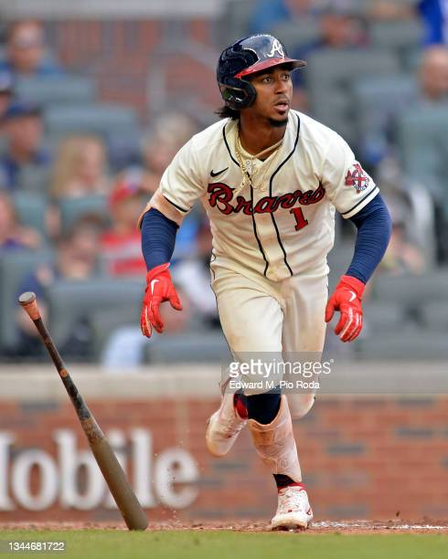 Ozzie Albies of the Atlanta Braves runs to first base during a game against the New York Mets at Truist Park on October 3, 2021 in Atlanta, Georgia.