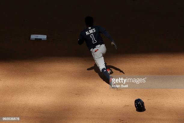 Ozzie Albies of the Atlanta Braves runs to second base in the eighth inning against the Milwaukee Brewers at Miller Park on July 7 2018 in Milwaukee...