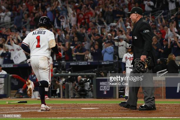 Ozzie Albies of the Atlanta Braves scores during the first inning of Game Six of the National League Championship Series against the Los Angeles...