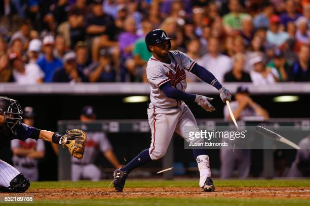 Ozzie Albies of the Atlanta Braves shatters his bat en route to grounding out in the fifth inning during the game against the Colorado Rockies at...