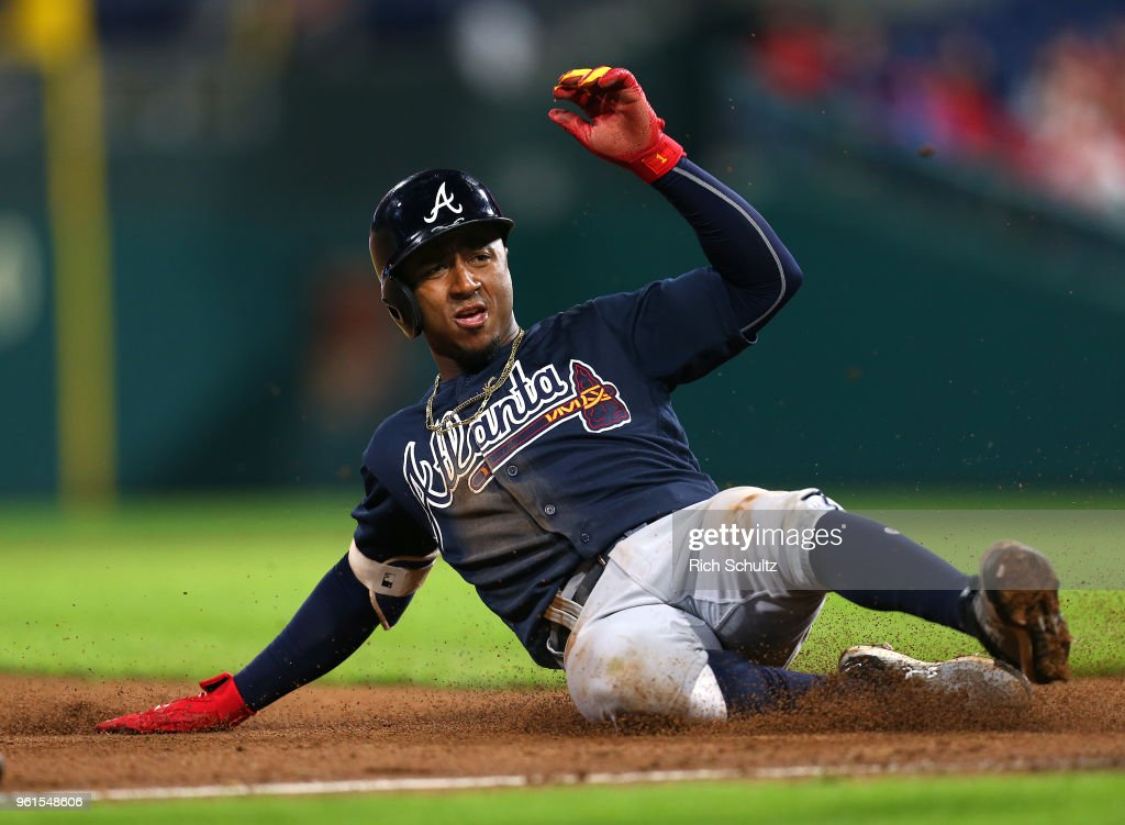 Ozzie Albies #1 of the Atlanta Braves slides into third base on a throwing error by right fielder Nick Williams of the Philadelphia Phillies on a single by Freddie Freeman during the fifth inning of a game at Citizens Bank Park on May 22, 2018 in Philadelphia, Pennsylvania. The Braves defeated the Phillies 3-1.