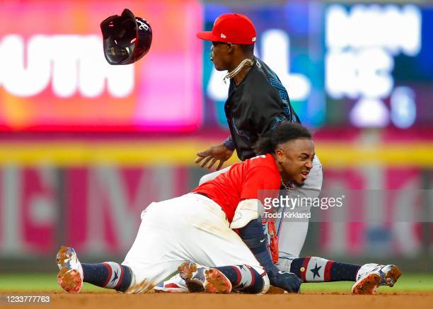 Ozzie Albies of the Atlanta Braves steals second after beating the tag of Jazz Chisholm Jr. #2 of the Miami Marlins in the seventh inning of an MLB...
