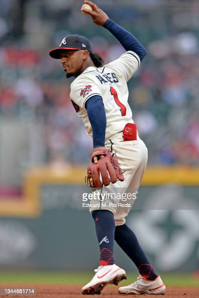 Ozzie Albies of the Atlanta Braves throws to first base during a game against the New York Mets at Truist Park on October 3, 2021 in Atlanta, Georgia.