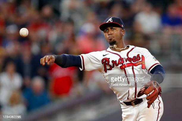 Ozzie Albies of the Atlanta Braves throws to first for the final out in the ninth inning of an MLB game against the San Diego Padres at Truist Park...