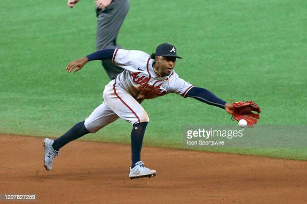 Ozzie Albies of the Braves extends himself to reach the baseball during the game between the Atlanta Braves and Tampa Bay Rays on July 28, 2020 at...