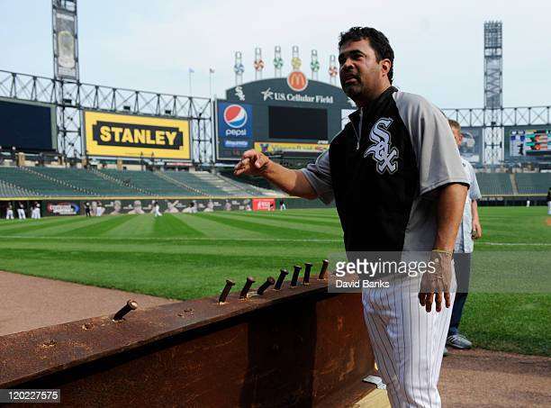 Ozzie Guillen manager of the Chicago White Sox looks at an 8foot steel Ibeam from the World Trade Center wreckage on display during the Chicago White...