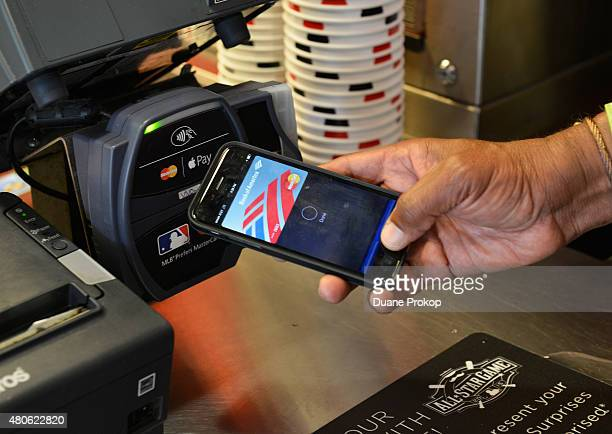 Ozzie Smith uses Apple Pay at the Home Run Derby at Great American Ball Park on July 13 2015 in Cincinnati Ohio