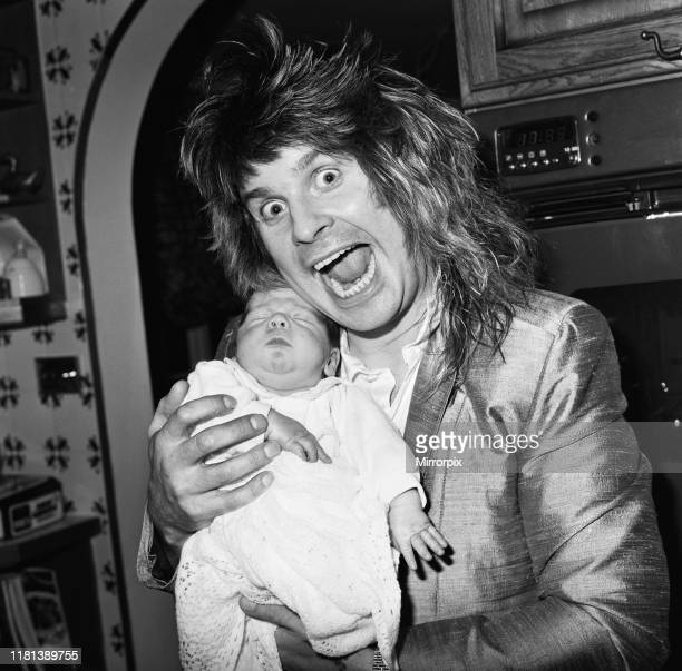 Ozzy Osbourne, former lead singer of Black Sabbath, pictured at home two weeks after the birth of his baby boy Jack. 25th November 1985.