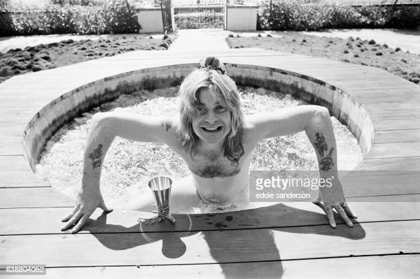 Ozzy Osbourne former lead singer of Black Sabbath pictured in his open air hot tub in the garden of his luxury home in Beverly Hills Los Angeles...