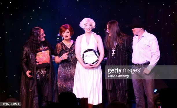 Ozzy Osbourne impersonator Sergio Casasanta, Sharon Osbourne impersonator Caroline Bernstein, Marilyn Monroe impersonator and recipient of the...