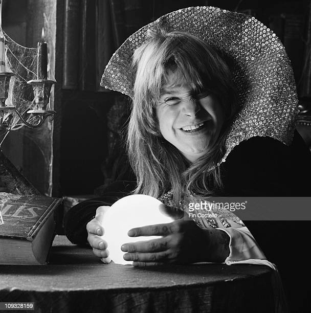 Ozzy Osbourne posed with cape and devil horns and crystal ball during the 'Diary Of A Madman' LP cover session in London in September 1981