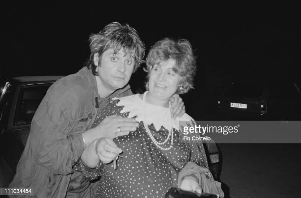 Ozzy Osbourne poses with his wife Sharon Osbourne at Ridge Farm Studios in West Sussex during the recording of 'Bark At The Moon' album in August...