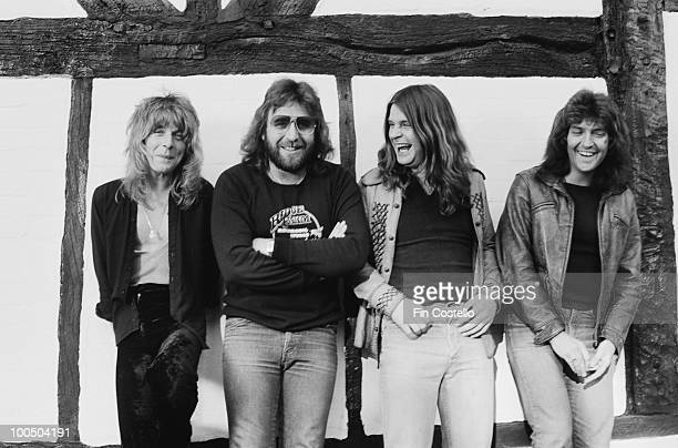 Ozzy Osbourne records his 'Blizzard of Ozz' album at Ridge Farm Studio 1980 From left to right guitarist Randy Rhoads drummer Lee Kerslake Ozzy...
