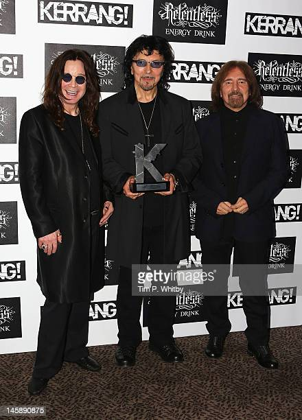 Ozzy Osbourne Tony Iommi and Geezer Butler of Black Sabbath with their Inspiration Award during the Kerrang Awards at The Brewery on June 7 2012 in...
