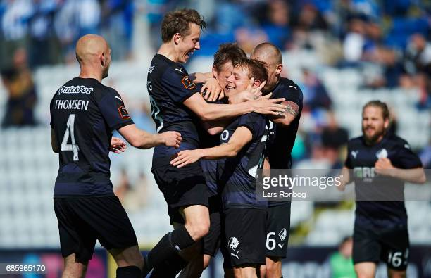$p$ Viktor Lundberg Joni Kauko Joel Allansson and Marvin Pourie of Randers FC celebrate after scoring their first goal during the Danish Alka...