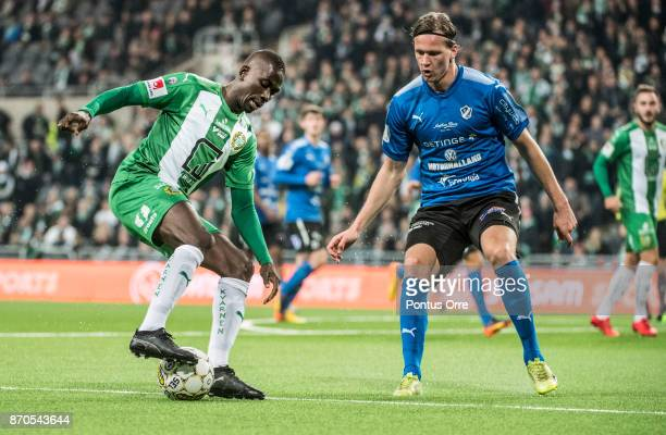 Pa Amat Dibba of Hammarby IF and Alexander Berntsson of Halmstad BK during the Allsvenskan match between Hammarby IF and Halmstad BK at Tele2 Arena...