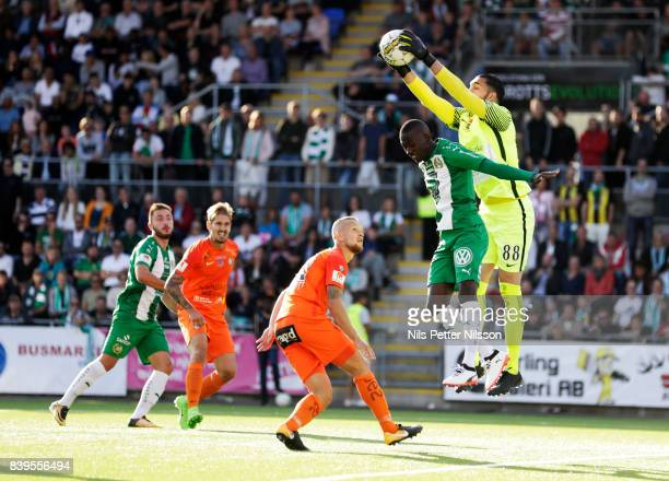 Pa Amat Dibba of Hammarby IF and Alireza Haghighi goalkeeperof Athletic FC Eskilstuna competes for the ball during the Allsvenskan match between...