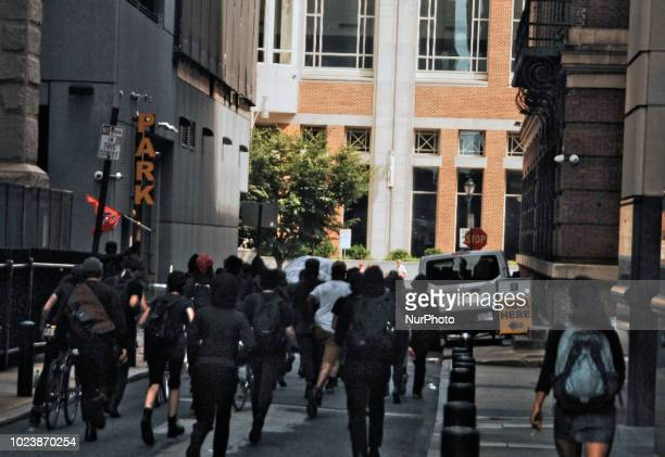 PHILADELPHIA Pa AntiFascist counter protest a propolice demonstration organized by the AltRight front group Sports Beer and Politics on August 25 2018