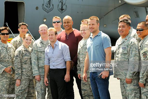 Pa Make Loa Scott Caan LL COOL J and Chris O'Donnell pose with members of the US Air Force at Hickam Air Force Base on the island of Oahu while...