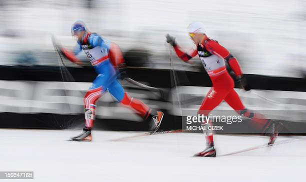 Paal Golberg of Norway and Alexander Panzhinskiy of Russia compete during the men 16 km Free sprint event of the FIS CrossCountry World Cup on...