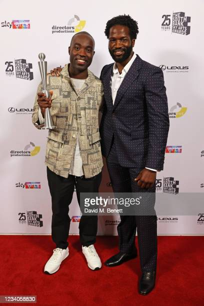 """Paapa Essiedu, accepting the award for TV Drama for """"I May Destroy You"""", and presenter Sope Dirisu pose in the winners room at the South Bank Sky..."""