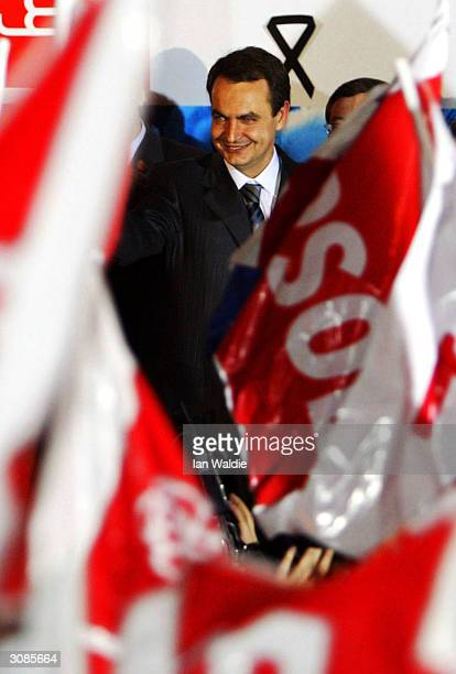 Paartido Socialista Obrero Espanol party leader Jose Luis Rodriguez Zapatero stands on the stage of the party head quarters and claims victory in...