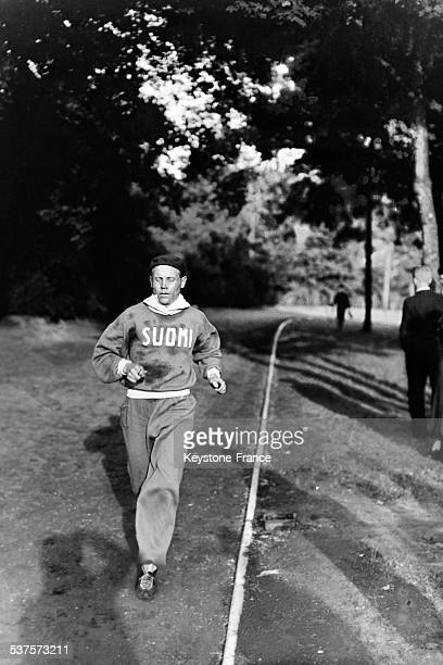 Paavo Nurmi in a race, Paris, France, in 1930.