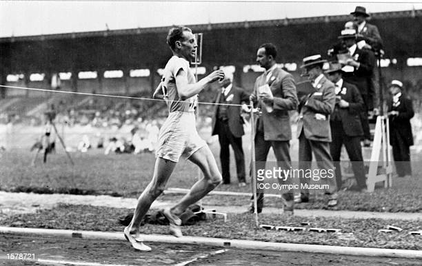 Paavo Nurmi of Finland crosses the finish line to win a race at the 1924 Olympic Games in Paris. In the history of athletics no man has taken so many prizes, set world records and changed the attitude to running as Nurmi. His 22 world records ranged from 1500 metres to 20 kilometres, and caused much re-thinking about the way to build up strength and then conserve it during races. For much of his career, Nurmi trained and raced with a stop watch in hand, believing that pace judgement was a crucial factor in achieving the optimum performance. In the Games of 1924 and 1928 he won ten gold medals and three silver medals and would probably have added to that collection in the marathon at Los Angeles in 1932, had he not been disqualified from athletics for alleged professionalism just before the Games. The decision embittered him but that was eased when he was allowed to run in domestic competition, and by the roar which greeted him when at the age of 55 he ran into the Olympic Stadium at Helsinki in 1952 with the Olympic torch to light the flame at the opening ceremony for the Games of the 15th Olympiad. Mandatory Credit: IOC/Allsport