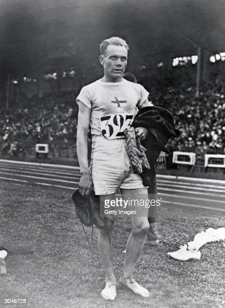 Paavo Nurmi of Finland winner of the Men's 10,000m, stands on the field during the VII Olympic Games on April 20, 1920 in Antwerp, Belgium.
