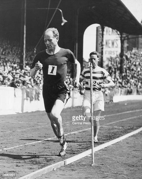 Paavo Nurmi running in the four miles invitation record race at Stamford Bridge, 25th May 1931. He failed to beat the record by fifteen seconds.
